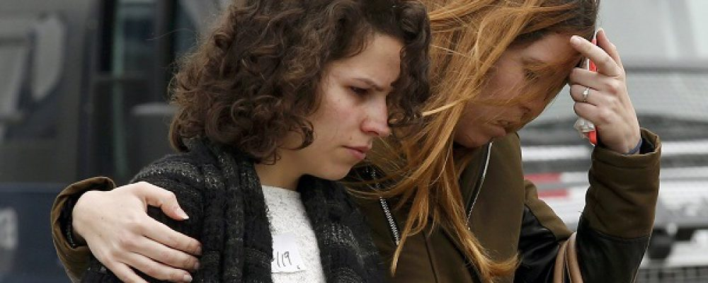 Family members of passengers feared killed in Germanwings plane crash react at Barcelona's El Prat airport March 24, 2015. No one survived when an Airbus A320 passenger plane operated by Lufthansa's budget subsidiary Germanwings flight crashed in southern France on Tuesday and it is likely to take days to recover the bodies of those on board due to difficult terrain, French police at the crash site said.     REUTERS/Gustau Nacarino