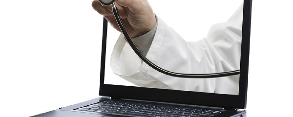 Doctors hand holding a stethoscope through a laptop screen towards a patient